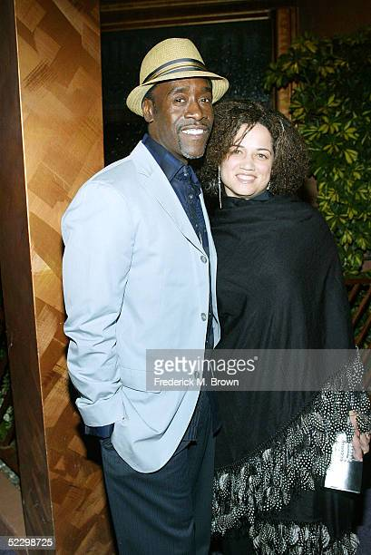 Actor Don Cheadle and his wife attend the Ebony Magazine Oscar Party Hollywood in Harlem at the Crustacean Restaurant on February 24 2005 in Beverly...