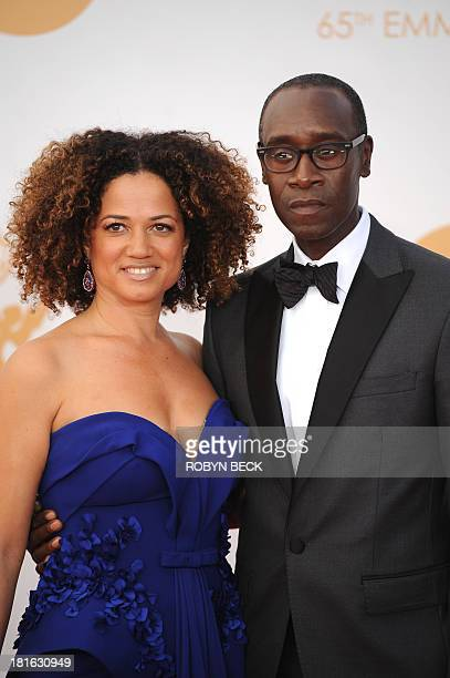 Actor Don Cheadle and his wife Bridgid Coulter arrive on the red carpet for the 65th Emmy Awards in Los Angeles California on September 22 2013 AFP...
