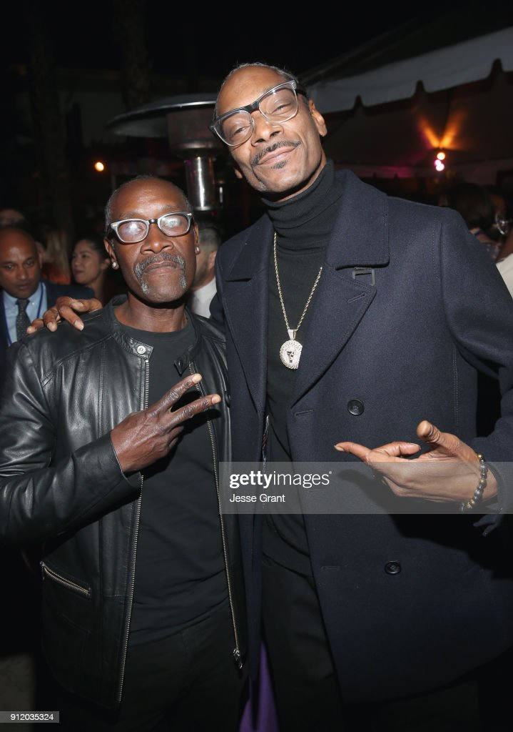 Actor Don Cheadle (L) and rapper Snoop Dogg at the Los Angeles World Premiere of Marvel Studios' BLACK PANTHER at Dolby Theatre on January 29, 2018 in Hollywood, California.