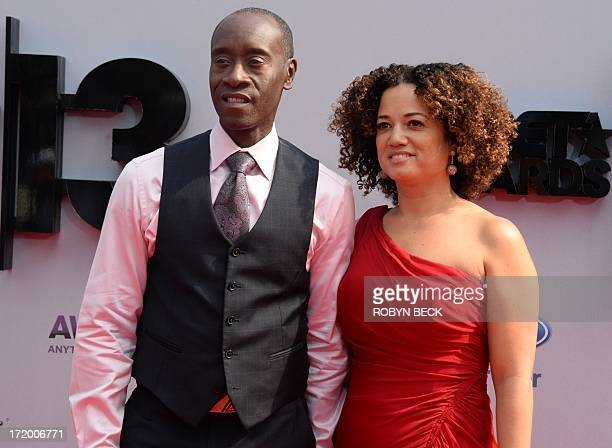 Actor Don Cheadle and wife Bridgid Coulter arrive for the 2013 BET Awards at the Nokia Theatre LA Live in Los Angeles on June 30 2013 The awards...