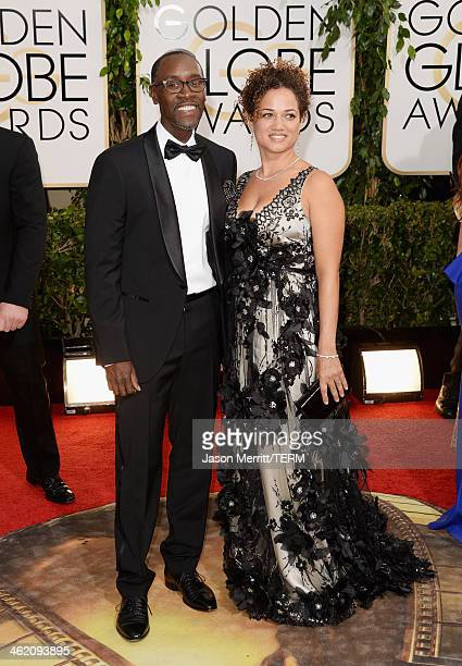 Actor Don Cheadle and wife Bridgid Coulture attend the 71st Annual Golden Globe Awards held at The Beverly Hilton Hotel on January 12 2014 in Beverly...