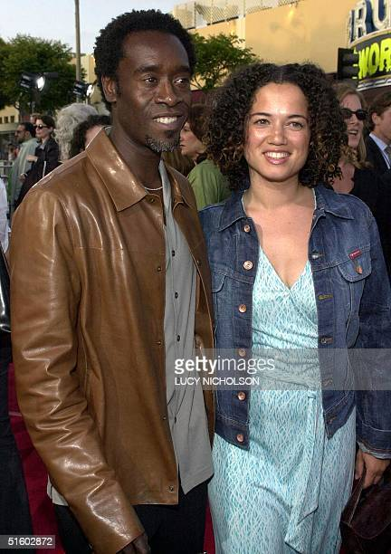 US actor Don Cheadle arrives at the premiere of his new film Swordfish with his wife Bridgit Coulter in Los Angeles 04 June 2001 AFP PHOTO/Lucy...