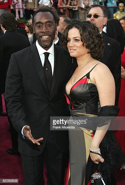 Actor Don Cheadle nominated for Best Actor for his role in Hotel Rwanda and wife Bridgid Coulter arrive at the 77th Annual Academy Awards at the...