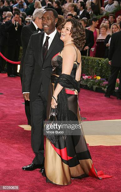 Actor Don Cheadle nominated for Best Actor in a Leading Role for his performance in Hotel Rwanda arrives with his wife Bridgid Coulter to the 77th...