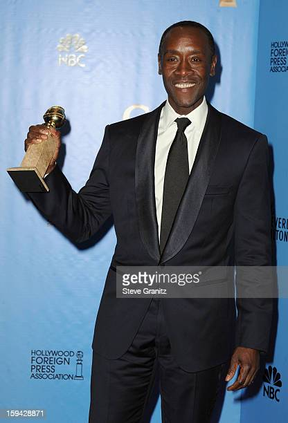 Actor Don Cheadle poses in the press room at the 70th Annual Golden Globe Awards held at The Beverly Hilton Hotel on January 13 2013 in Beverly Hills...