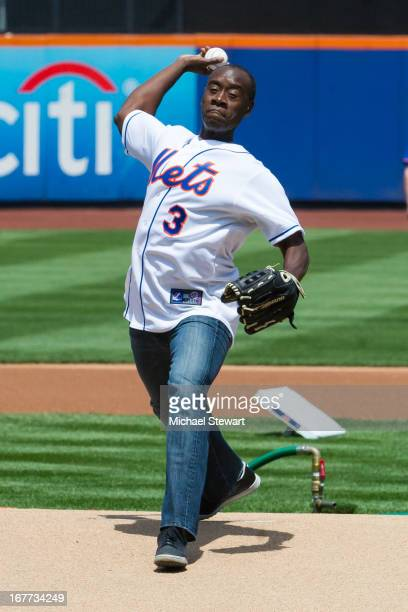 Actor Don Cheadle throws out the first pitch before the Philadelphia Phillies vs New York Mets game at Citi Field on April 28 2013 in New York City