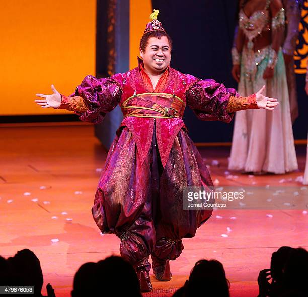 Actor Don Darryl Rivera takes a bow during curtain call at the the 'Aladdin' On Broadway Opening Night at New Amsterdam Theatre on March 20 2014 in...