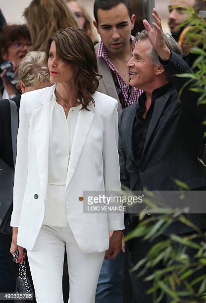 US actor Don Johnson and his wife Kelley Phleger arrive for a show on the set of the French tv channel Canal Plus on the sidelines of the 67th...