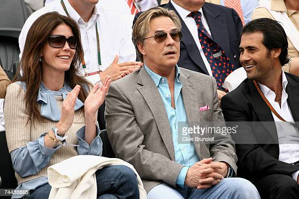 Actor Don Johnson and his wife Kelley Phleger watch Nikolay Davydenko of Russia play Roger Federer of Switzerland in the Men's Singles Semi Final on...
