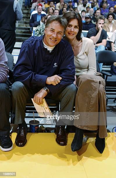 Actor Don Johnson and his wife Kelley watch the Los Angeles Lakers take on the Milwaukee Bucks during the NBA preseason game at Staples Center on...