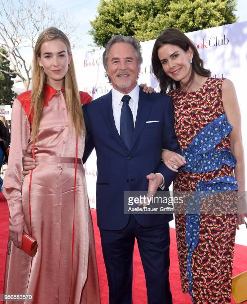 Actor Don Johnson daughter Grace Johnson and wife Kelley Phleger arrive at the premiere of Paramount Pictures' 'Book Club' at Regency Village Theatre...