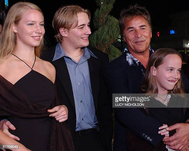 US actor Don Johnson hugs his daughter Dakota as he arrives with his son Jessie and Jessie's girlfriend Anna at the Los Angeles premiere of Harry...