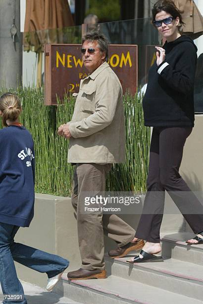 Actor Don Johnson leaves the Newsroom restaurant after having lunch with his pregnant wife Kelley Phleger and his daughter Dakota from his marriage...