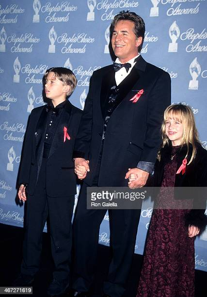 Actor Don Johnson Melanie Griffith's son Alexander Bauer and daughter Dakota Johnson attend the 23rd Annual People's Choice Awards on January 12 1997...