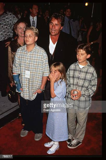 """Actor Don Johnson stands with ex-wife Patti D''Arbanville and their kids at the premiere of """"Tin Cup"""" August 6, 1996 in New York City. Kevin Costner..."""