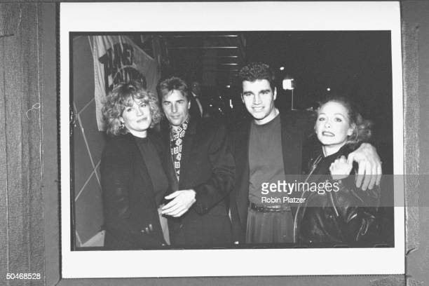 Actor Don Johnson w actress wife Melanie Griffith posing w actress Patti D'Arbanville the mom of Don's son her beau Terry Quinn at the opening of...