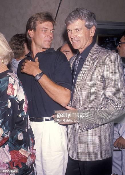 Actor Don Murra and son Christopher Murray attend the Presumed Innocent Westwood Premiere on July 25 1990 at Mann Bruin Theatre in Westwood California