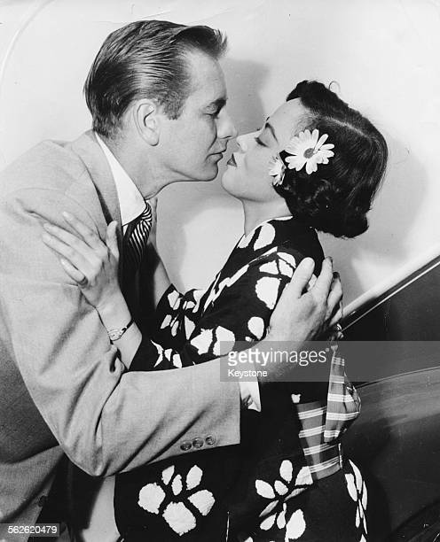 Actor Don Taylor teaching Yoshiko 'Shirley' Yamaguchi how kiss like an American as she plans to start making movies in Hollywood circa 1942