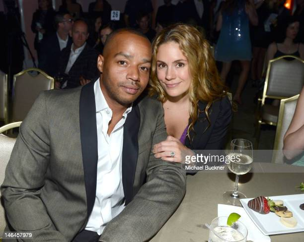 Actor Donald Faison and Cacee Cobb attend the 100th anniversary celebration of the Beverly Hills Hotel Bungalows supporting the Motion Picture...