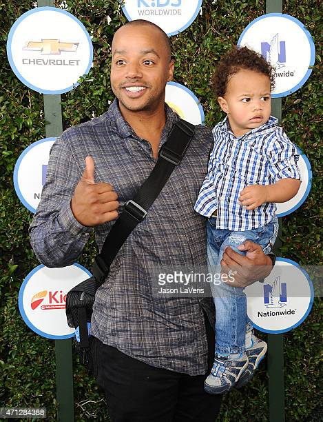 Actor Donald Faison and son Rocco Faison attend Safe Kids Day at The Lot on April 26 2015 in West Hollywood California