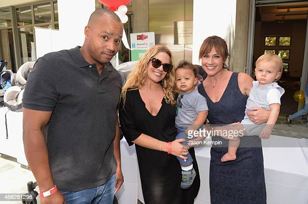 Actor Donald Faison CaCee Cobb Rocco Faison actress Nikki DeLoach and William Hudson Goodell attend the 3rd annual red CARpet safety awareness event...
