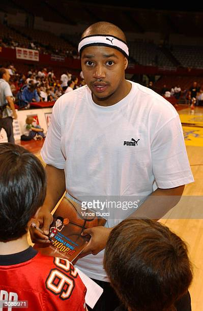 Actor Donald Faison signs autographs at the Frankie Muniz HoopLA celebrity charity basketball game presented by Pokemon Trading Card Games on March...