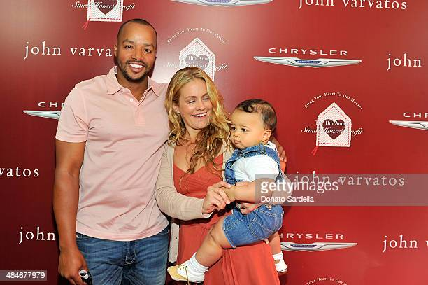 Actor Donald Faison wife CaCee Cobb and son Kobe Faison arrive at the John Varvatos 11th Annual Stuart House Benefit presented by Chrysler Kids Tent...