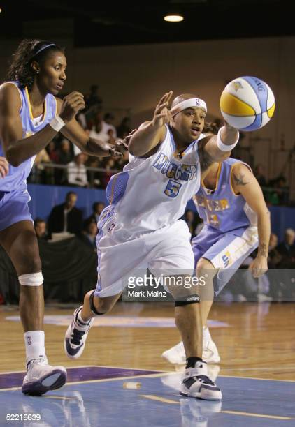 Actor Donald Fasion of Team Nuggets pass the ball during the McDonald's NBA AllStar Celebrity Game at the Colorado Convention Center on February 18...