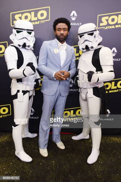 Actor Donald Glover and Stormtroopers attend a 'Solo A Star Wars Story' party at the Carlton Beach following the film's out of competition screening...