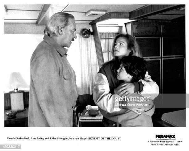 Actor Donald Sutherland actress Amy Irving and Rider Strong on set of the movie 'Benefit of the Doubt ' circa 1993