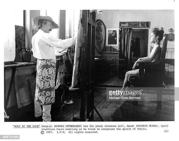 Actor Donald Sutherland and actress Valeri Glandut on set of the movie Oviri circa 1987