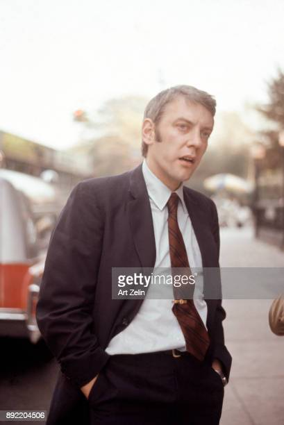 Actor Donald Sutherland stands outdoors with his hands in his pockets New York City 1960
