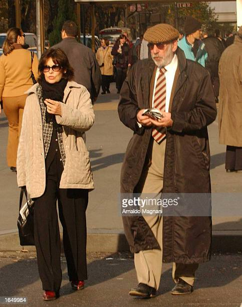 Actor Donald Sutherland walks with his wife actress Francine Racette along Fifth Avenue November 15 2002 in New York City