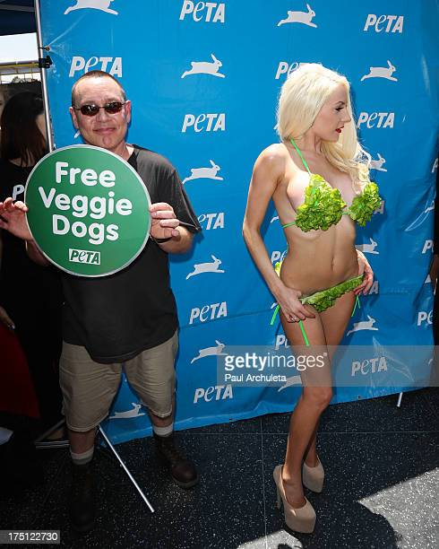 Actor Doug Hutchison and his wife TV Personality Courtney Stodden poses in a lettuce leaf bikini for PETA at Hollywood Highland Center on July 31...