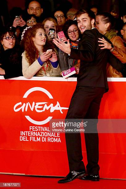Actor Douglas Booth poses with fans as he attends 'Romeo And Juliet' Premiere during The 8th Rome Film Festival at Auditorium Parco Della Musica on...