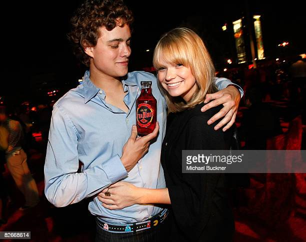 Actor Douglas Smith and actress Amanda Heard attend the after party for the Los Angeles premiere of HBO's series 'True Blood' at the Cinerama Dome on...
