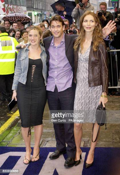 Actor Dougray Scott waves as he and costars Kate Winslet and Saffron Burrows arrive for the premiere of the film 'Enigma' at the Odeon cinema in...