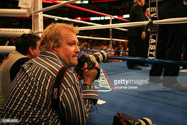 Actor Drew Carey prepares to photograph the WBO World Heavyweight Championship bout between Lamon Brewster and Andrew Golota on May 21 2005 at the...