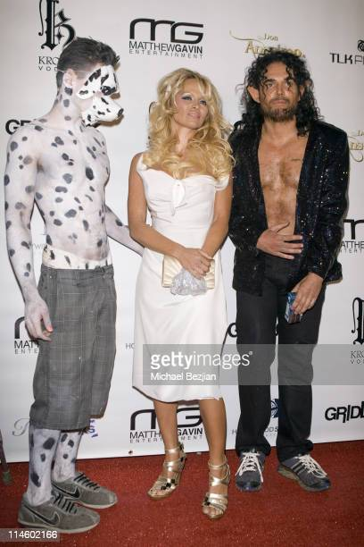 Actor Drew Kuhse, host actress Pamela Anderson and photographer David LaChapelle arrive at the 4th Annual Gridlock 2010 New Year's Eve Bash at...