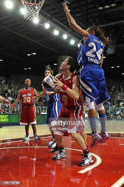 Actor Drew Scott of the West team shoots the ball over Tamika Catchings of the Indiana Fever and East team during the Sprint AllStar Celebrity Game...