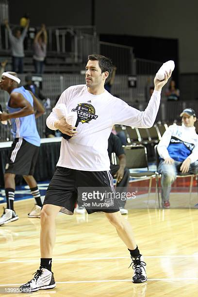Actor Drew Scott throws tshirts to the crowd during the Celebrity Shooting Stars on center court at Jam Session during the NBA AllStar Weekend on...