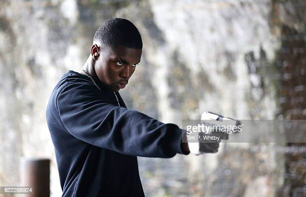 Actor Duayne Boachie on the set of 100 Streets in Battersea on September 1 2014 in London England