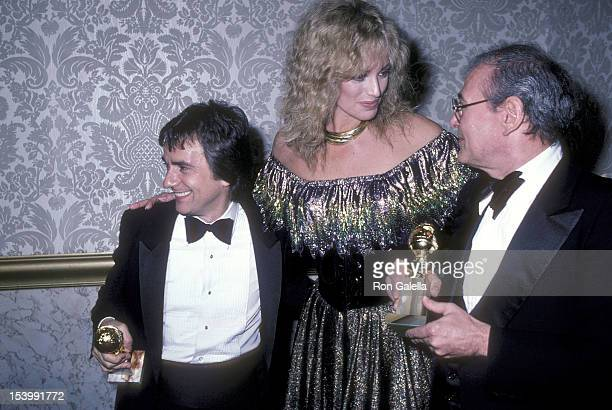 Actor Dudley Moore actress Susan Anton and producer Charles H Joffe attend the 39th Annual Golden Globe Awards on January 30 1982 at the Beverly...