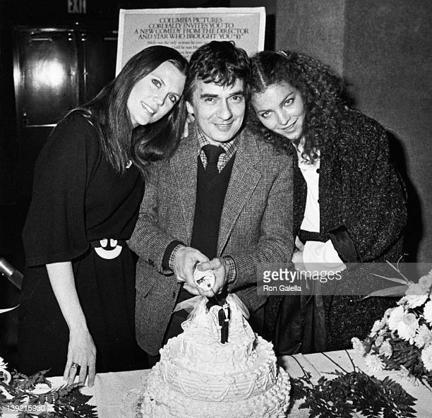 Actor Dudley Moore and actresses Ann Reinking and Amy Irving attend the premiere of Micki and Maude on December 2 1984 at Cinema III in New York City