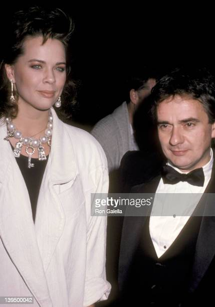Actor Dudley Moore and date Brogan Lane attend the Aren't We All Opening Night Performance on October 25 1985 at Wilshire Theatre in Beverly Hills...