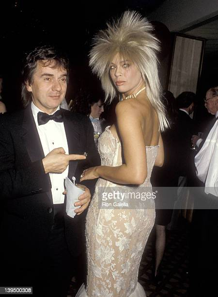 Actor Dudley Moore and date Brogan Lane attend the First Annual American Cinematheque Award Salute to Eddie Murphy on February 28 1986 at Century...
