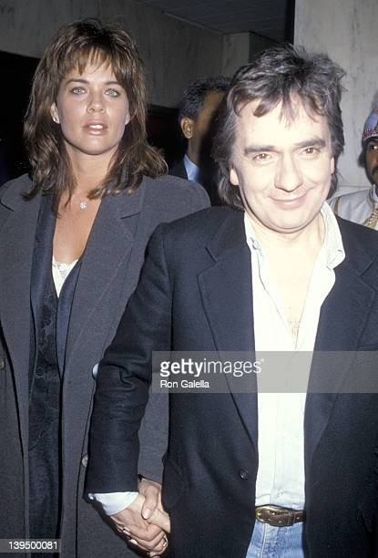 Actor Dudley Moore and date Brogan Lane attend the Saturday Night Live Cast and Crew Post Party on January 25 1986 at the Nirvana Club in New York...