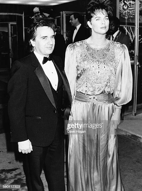 Actor Dudley Moore and his girlfriend Brogan Lane attending the premiere of the film 'Santa Claus The Movie' in London November 26th 1985