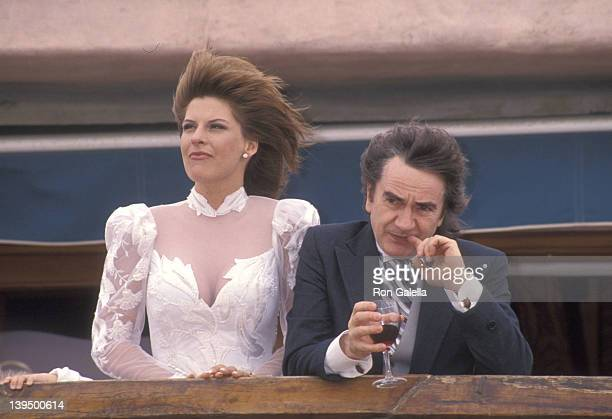 Actor Dudley Moore and his new bride Nicole Rothschild greet photographers at their wedding on April 16 1994 at Dudley Moore's Home 5505 Ocean Front...