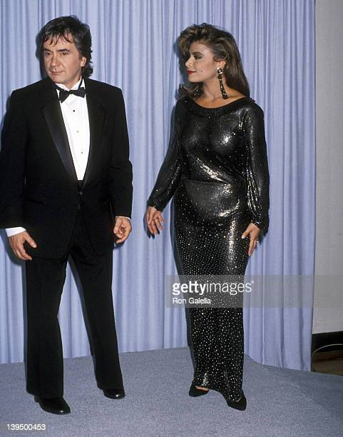 Actor Dudley Moore and singer Paula Abdul attend the 62nd Annual Academy Awards on March 26 1990 at Dorothy Chandler Pavilion Los Angeles Music...